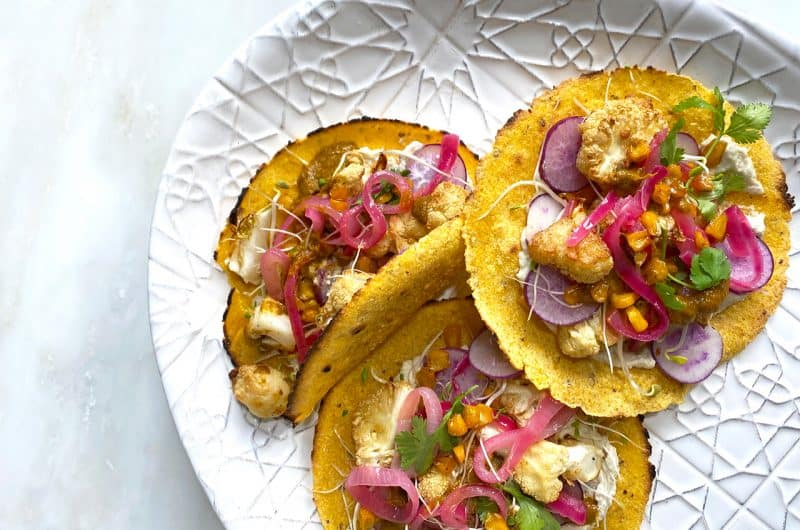 Roasted cauliflower and sweetcorn tacos with pickled pink onions