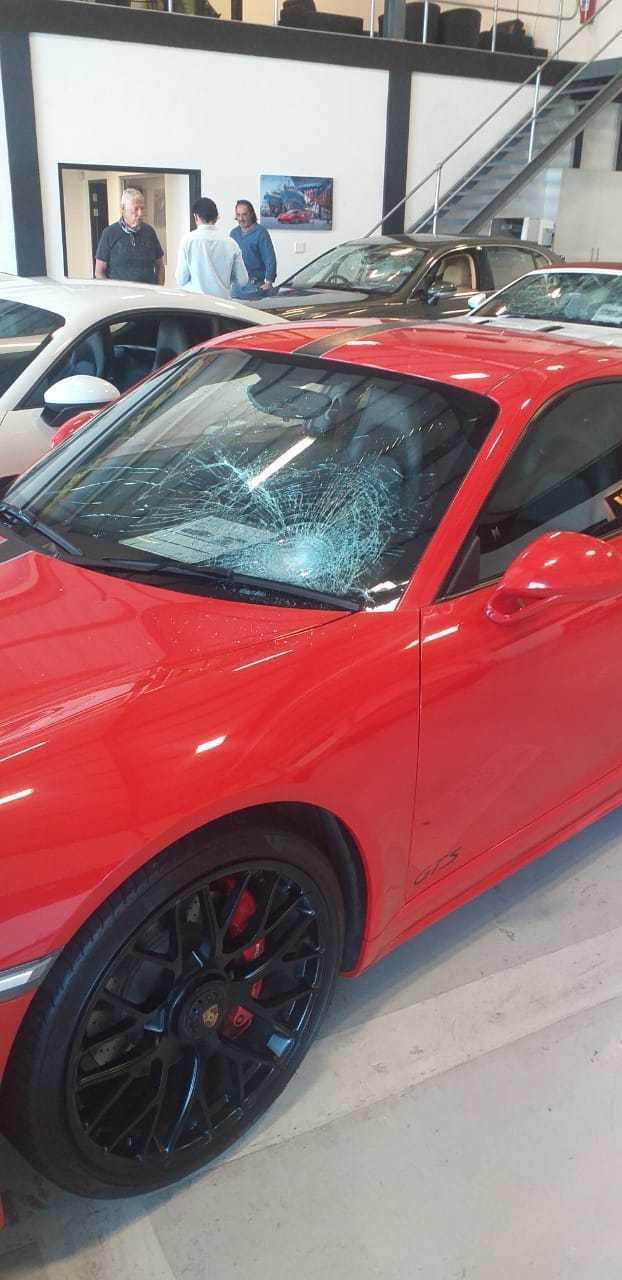 IMG 20210217 WA0026 - Watch: Gang storms CT dealership, smashing windows of luxury cars
