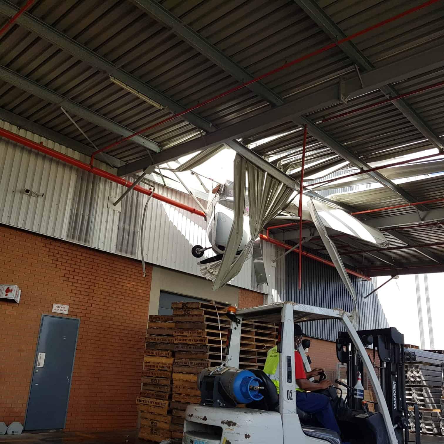 plane 2 - WTF? Plane slams into warehouse near Johannesburg [photos]